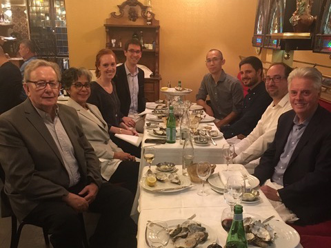 President Alan W. Cramb enjoys dinner with a group of alumni in October 2018 in Paris.